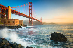The Golden Gate Bridge, seen at sunrise from Fort Point  Stock Images