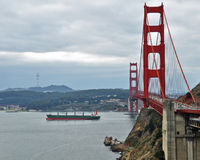 Golden gate bridge with ship sailing Royalty Free Stock Images