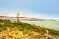 Golden Gate Bridge south shore. Red Golden Gate Bridge with green grass as foreground from south shore. Symbol of San Francisco, California, United States stock image