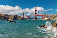Golden Gate Bridge at sunny day from Baker Beach. Golden Gate Bridge at sunny day seen from San Francisco beach, California Stock Photography