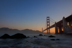 Golden Gate Bridge. At sunrise over ocean stock photos