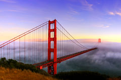 Golden Gate Bridge at Sunset. The Golden Gate Bridge covered in fog from Battery Spencer in San Francisco, California royalty free stock photos