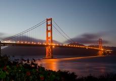 Golden Gate Bridge during sunset. Illuminated Golden Gate Bridge at night hours Royalty Free Stock Images