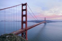 Golden Gate Bridge at sunset. Golden Gate Bridge with sunset colors in the background and ruins of old fortification in the foreground. Copyspace on the right Stock Photography