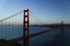 Golden Gate Bridge sunset. Scenic view of Golden Gate bridge illuminated at sunset, San Francisco bay, California, U.S.A Royalty Free Stock Photo
