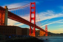 Golden Gate Bridge at Sunset from Fort Point. With colorful, wispy clouds royalty free stock image