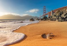 Golden Gate Bridge at Sunset. Seen from Marshall Beach, San Francisco, California royalty free stock photography