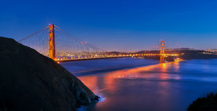 Golden Gate Bridge at Sunset. Reflects of the bay Royalty Free Stock Photography