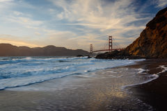 The Golden Gate Bridge at sunset, seen from Baker Beach, San Fra Royalty Free Stock Photo