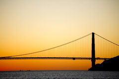 Golden Gate bridge sunset silhouette. The profile of the Golden Gate bridge silhouetted at sunset Stock Image