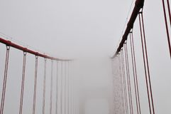 Creative, uncommon and unusual point of view and abstract of Golden Gate Bridge on a very foggy day San Francisco, California, USA. The Golden Gate Bridge is a royalty free stock image