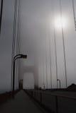 Golden Gate Bridge in thick fog. Golden Gate Bridge in ocean fog, daytime. The sun can hardly get through the haze royalty free stock photography