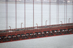Golden Gate Bridge and traffic on it Stock Photos
