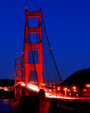 Golden Gate Bridge Under the Stars. San Francisco's Golden Gate Bridge at night, with stars visible in the sky and cars streaming over the bridge Royalty Free Stock Images