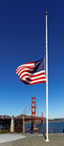 Golden Gate Bridge and USA flag. An American flag flowing in the wind against a background of Golden Gate Bridge, San Royalty Free Stock Photos