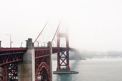 Golden Gate Bridge. A very foggy morning at the Golden Gate Bridge, San Francisco royalty free stock images