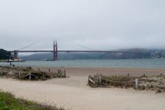 Golden Gate Bridge in Fog. View from Crissy Field in San Francisco royalty free stock image