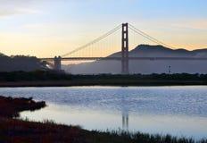 The Golden Gate Bridge and Wetlands at Crissy Field. San Francisco's Golden Gate Bridge reflected in the wetlands at Crissy Field at dusk Royalty Free Stock Photo