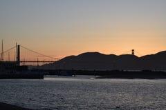 Golden gate bridge-Zonsondergang Royalty-vrije Stock Afbeeldingen