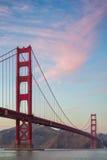 Golden gate bridge-Zonsondergangbeeld Stock Foto's