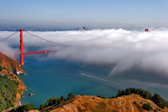 Golden gate in the clouds. San Francisco bridge on a beautiful day royalty free stock images
