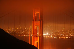 Golden Gate Bridge at night. Scenic view of Golden Gate Bridge at night with fog over illuminated city in background, San Francisco, California, U.S.A Royalty Free Stock Photos