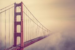 Golden Gate Into the Fog. Into the Fog. San Francisco Golden Gate Bridge Foggy Scenery Royalty Free Stock Image