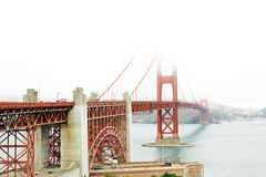 Golden Gate in a foggy day. The Golden Gate bridge in San Francisco, California, in a foggy day Stock Image
