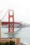 Golden Gate in a foggy day. The Golden Gate bridge in San Francisco, California, in a foggy day Royalty Free Stock Images