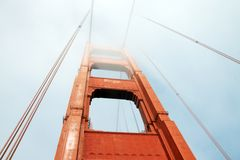 Golden Gate in a foggy day. The Golden Gate bridge in San Francisco, California, in a foggy day Stock Photos