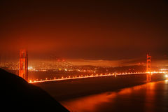 Golden Gate Bridge at night. With some fog and city lights. San Francisco, United States of America Royalty Free Stock Images