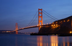 Golden Gate Glowing in the Dusk. Golden Gate Bridge is glowing in the dusk - as seen from Fort Baker in Sausalito, California Royalty Free Stock Image