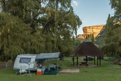 Sunrise at the Glen Reenen Rest Camp in Golden Gate. GOLDEN GATE HIGHLANDS NATIONAL PARK, SOUTH AFRICA - MARCH 14, 2018: The golden sandstone cliff of the Stock Photo