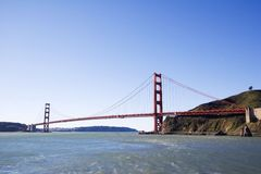 Golden Gate Moon. A view of the Golden Gate Bridge with the moon in the daytime sky Stock Photo