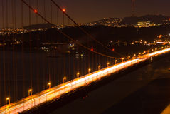 Golden Gate in Motion. Golden Gate Bridge with closeup of vehicles moving Royalty Free Stock Photos