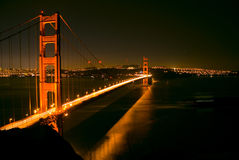 Golden Gate at Night. Golden Gate Bridge at night with cargo ship moving underneath stock photo