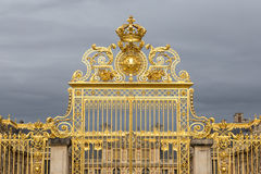 The golden gate of the Palace of Versailles, or Chateau de Versailles, or simply Versailles, in France Stock Images