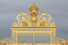 The golden gate of the Palace of Versailles, or Chateau de Versailles, or simply Versailles, in France Stock Photography