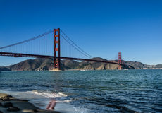 Golden Gate reflection on the water. In sunny day Royalty Free Stock Photography