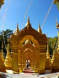The golden gate on stair of golden pagoda in Thailand stock image