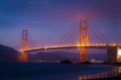 Golden Gate After Sunset in Summer. The Golden Gate in summer mist after sunset, Baker Beach, San Francisco Royalty Free Stock Images