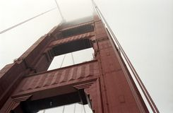 Golden Gate Tower. Upward shot of Golden Gate tower from road deck on a foggy day Stock Photo
