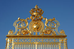 Golden gate of Versailles palace Stock Photos