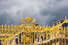 Golden gates od Versailes with the royal symbol Stock Photos