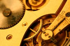 Golden gear. Shiny mechanical background Stock Images