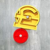 Golden gear with pound symbol Stock Photo
