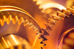 Golden gear wheels Stock Photography