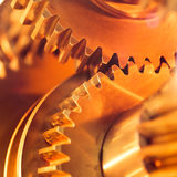 Golden gear wheels Stock Photos