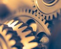 Golden gear wheels. Close-up view Stock Photo