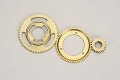 Golden gears. Gearwheels in golden metal Royalty Free Stock Photos